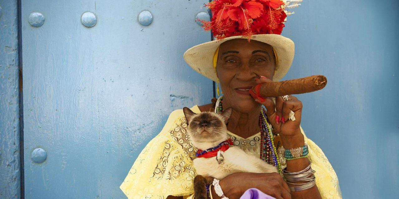 https://mytravelxp.com/wp-content/uploads/2021/03/cuba-woman-cigar-cat-istock-168263320-ratstuben-2048x1365web-1280x640.jpg